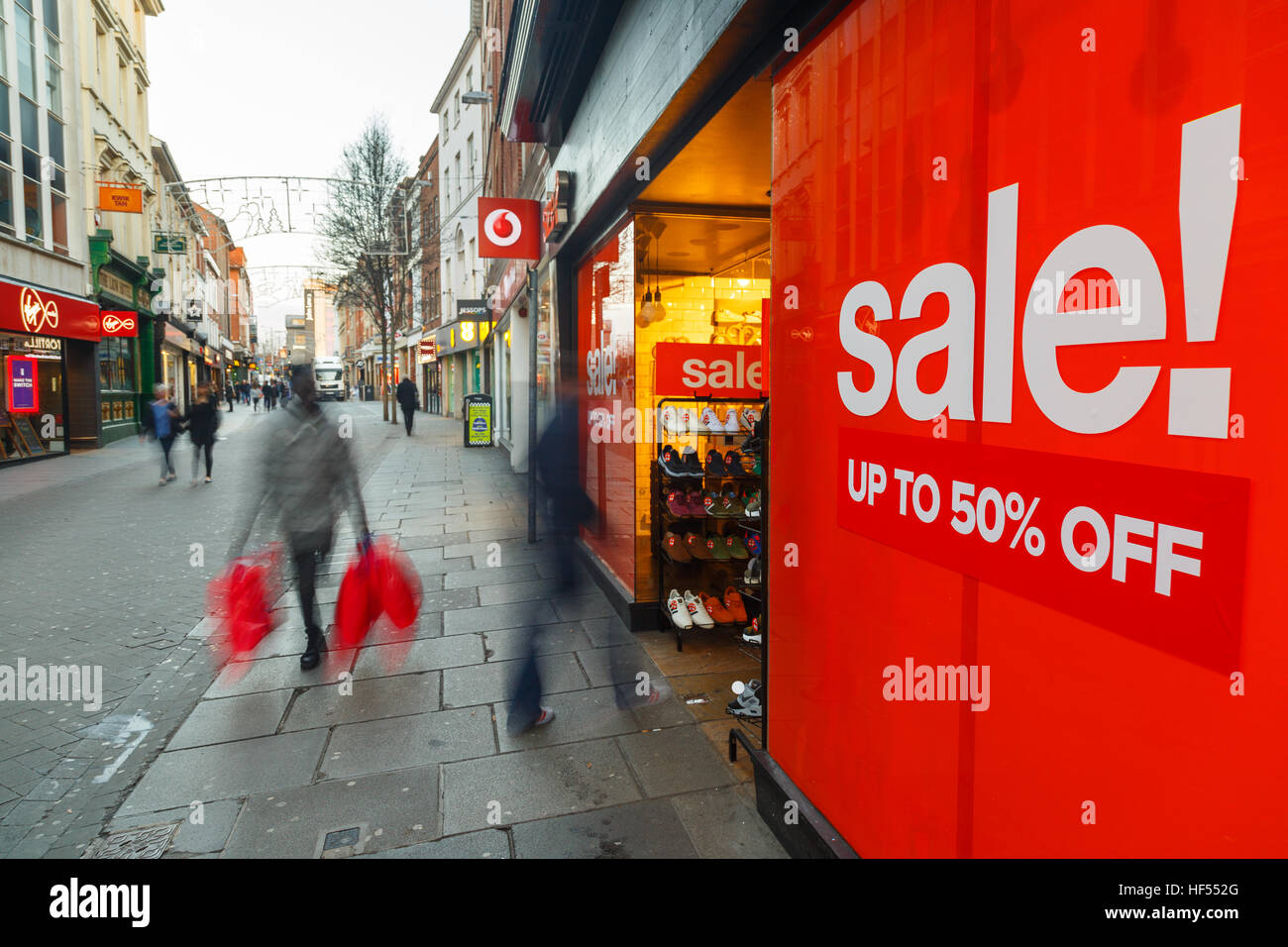Boxing Day sales poster and sales shoppers on Clumber Street in Nottingham, Britain. In Nottingham, England. On - Stock Image