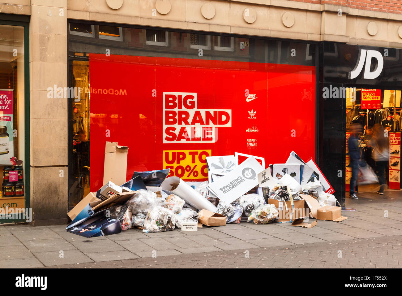Discarded Christmas POS outside JD Sports as Boxing Day sales start. In Nottingham, England. On 26th December 2016. - Stock Image
