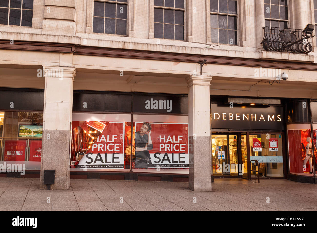Half price sale posters in Debenhams window on Boxing Day in Nottingham. In Nottingham, England. On 26th December - Stock Image