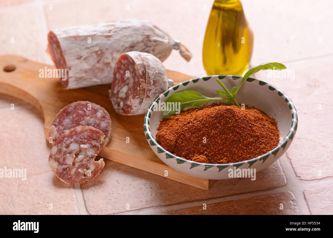 Pure pork salami with chili - traditional Italian food - Stock Image