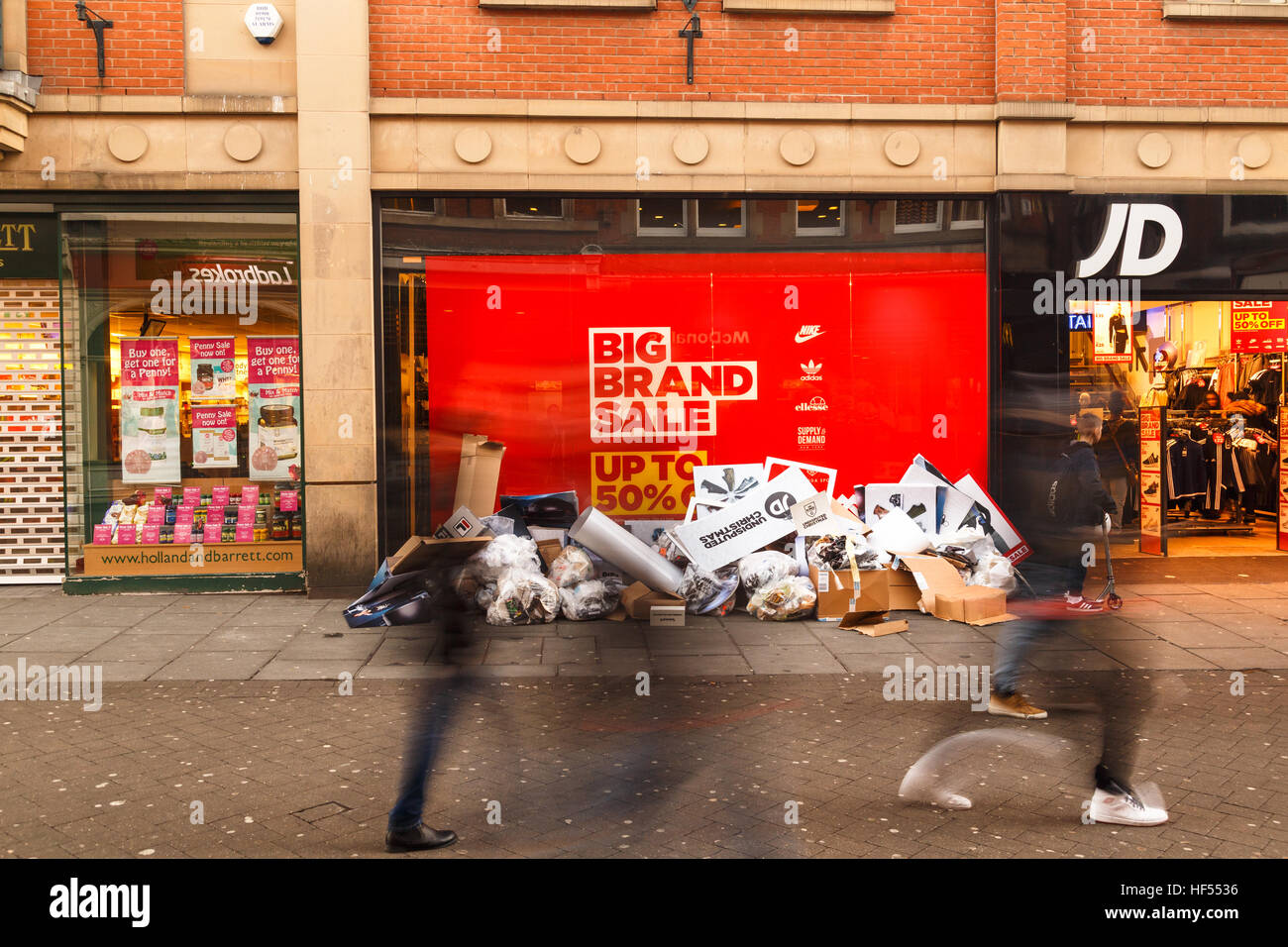 Shoppers pass, Boxing Day sale starts at JD Sports shop in Nottingham. In Nottingham, England. On 26th December - Stock Image