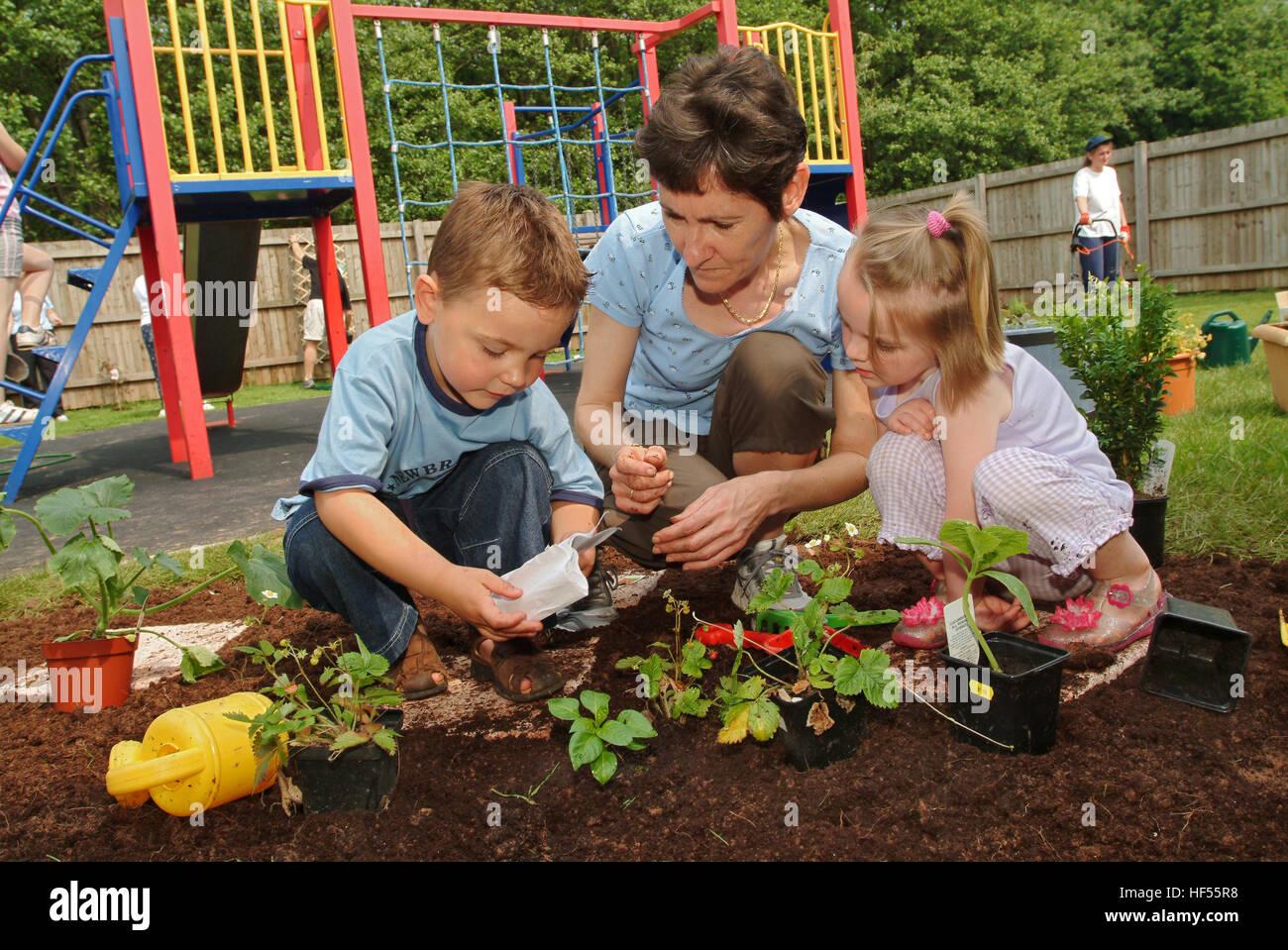 Children In Nursery School Garden Stock Photos & Children In Nursery ...