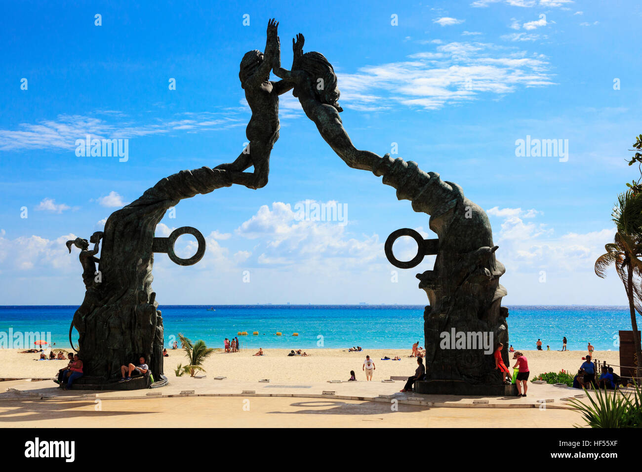 Entrance to the beach at Playa Del Carmen with symbols from the ancient Mayan culture, Riviera Maya, Mexico - Stock Image