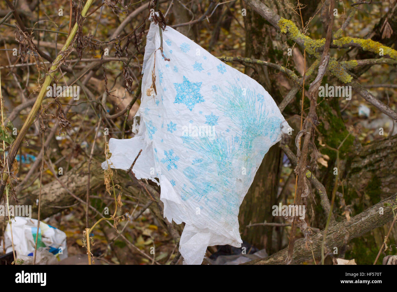 Pile of plastic bags and other refined petroleum products dumped in landfill. Garbage heap gives infiltrate into - Stock Image