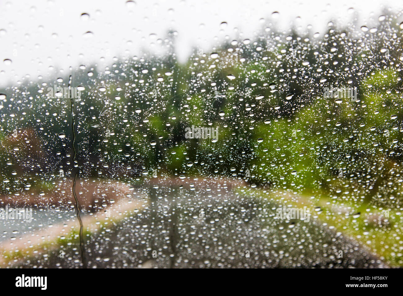 Water droplets on the windshield of an automobile - Stock Image