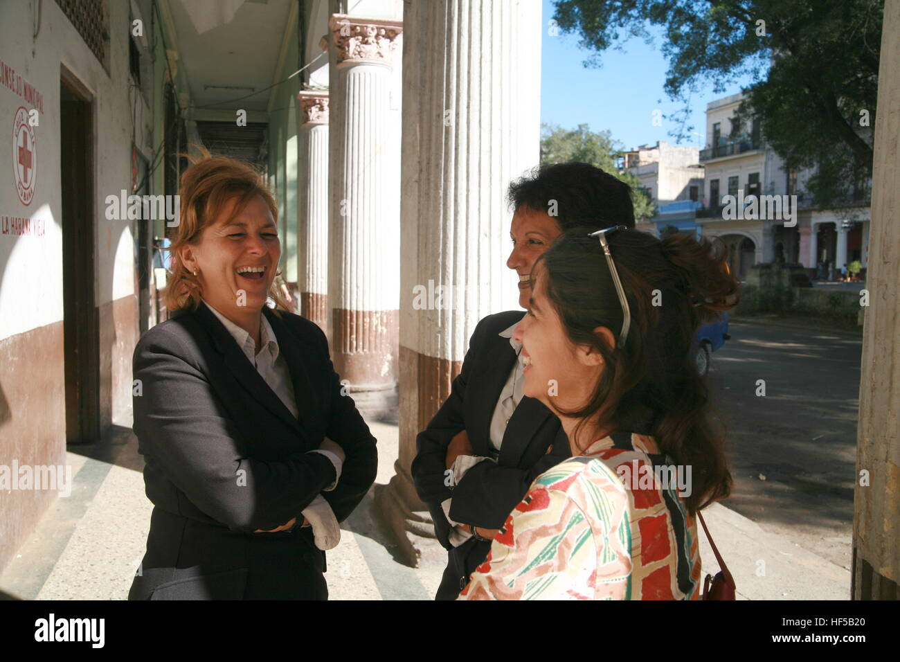 Three women having a chat, Paseo de Martí Street, Havana, Cuba, Caribbean, Americas - Stock Image