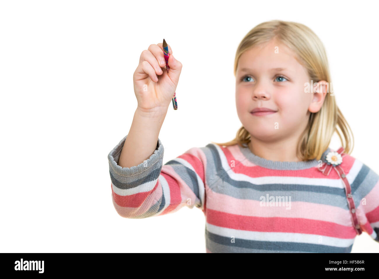 cute little girl drawing in the air or imaginary screen - Stock Image