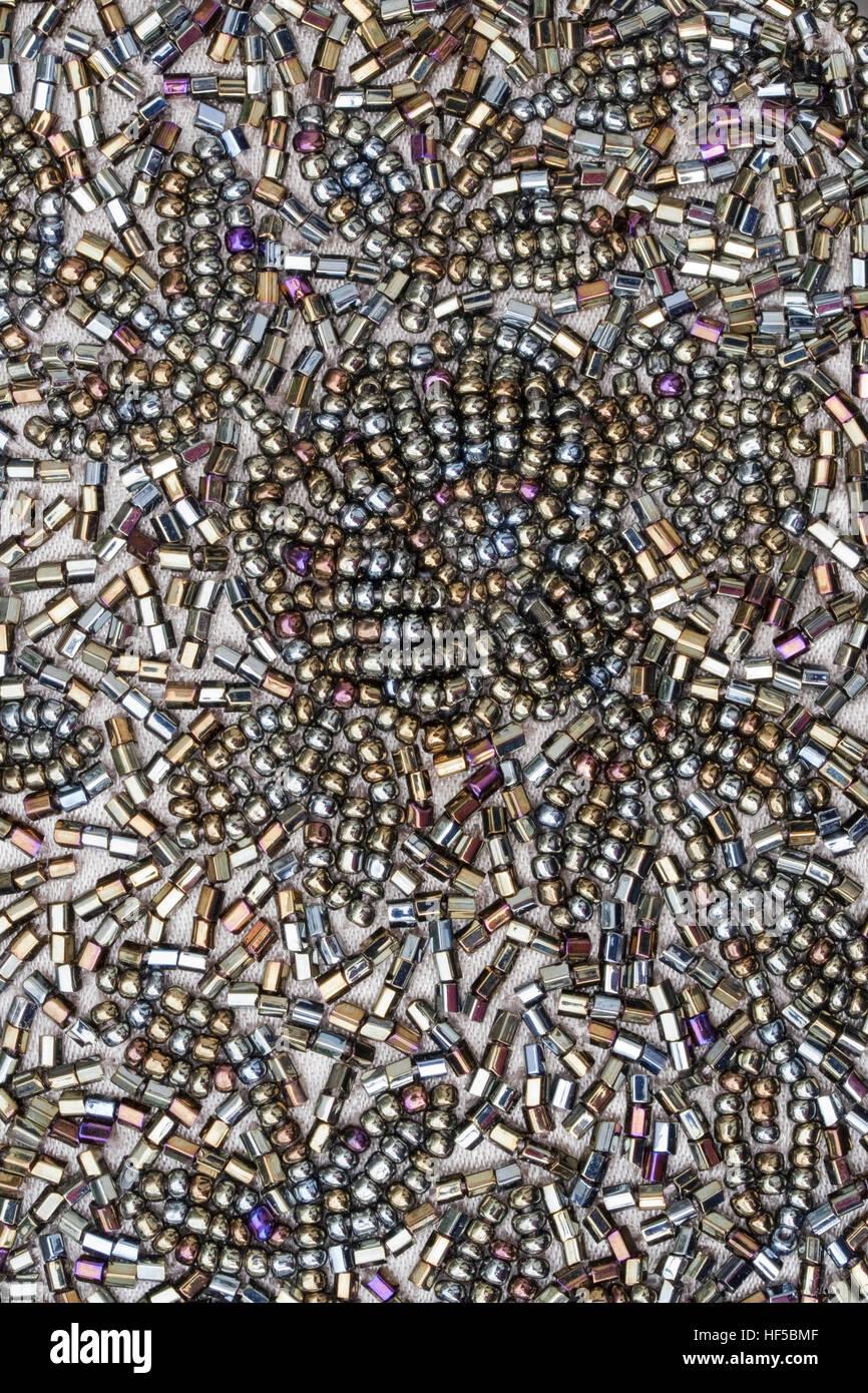 Closeup image of colourful beading on a handbag - Stock Image