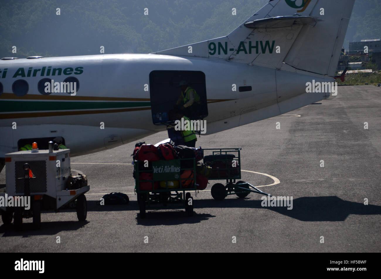 Baggage Handlers on a Jetstream 41Turboprop-powered Plane from Yeti Airlines Flight from Kathmandu to Pokhara, Nepal, - Stock Image