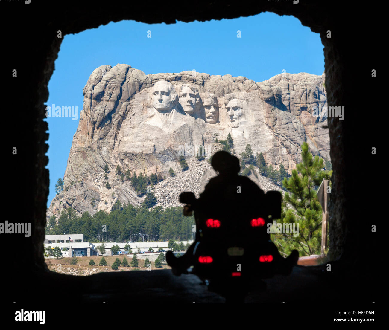 Mount Rushmore. A motorcycle riding through a tunnel on US-16A Scenic Byway towards Mount Rushmore National Memorial - Stock Image