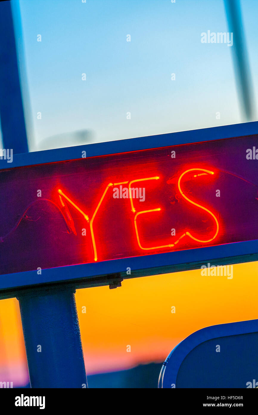 Yes sign. Neon sign Vacancy Yes at a US motel with Yes light switched on. - Stock Image