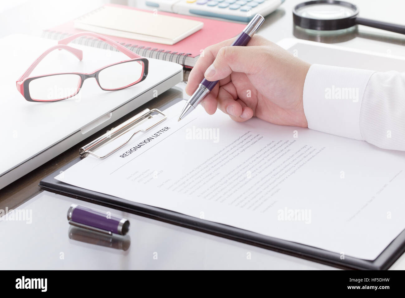 Businessman Signing His Resignation Letter On His Desk Before