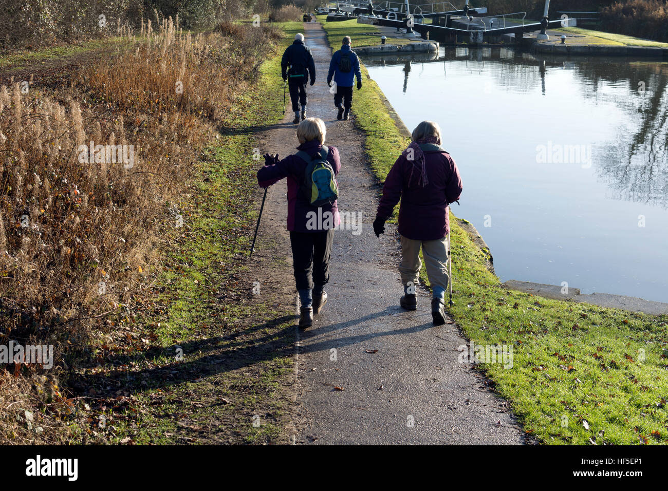 Walkers on the Grand Union Canal towpath in winter, Hatton Locks, Warwickshire, UK - Stock Image