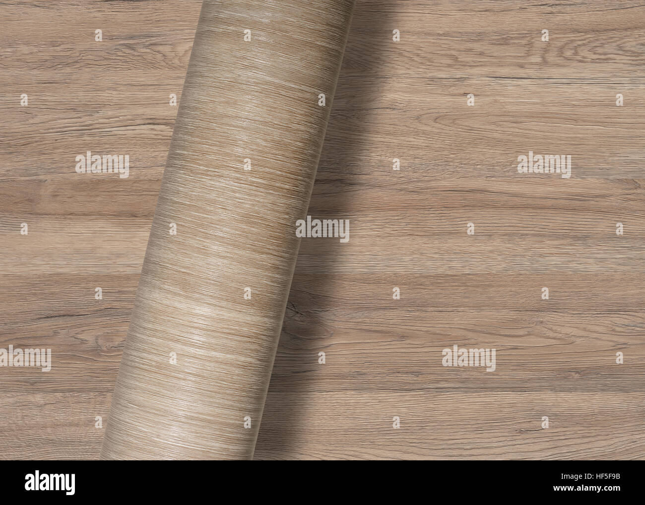 rolled wood-textured surface over same full frame textured background - Stock Image