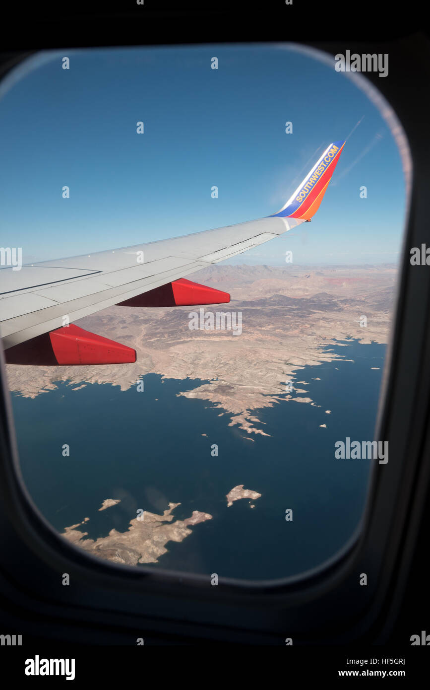 View out the window of a Southwest Airlines jet flying over Lake Mead on the Arizona - Nevada border. Stock Photo