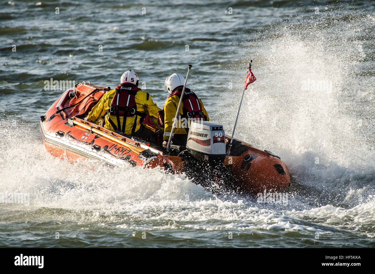 Members of the Southend RNLI practicing near Southend beach. They operate from the end of the pier. This is D class - Stock Image
