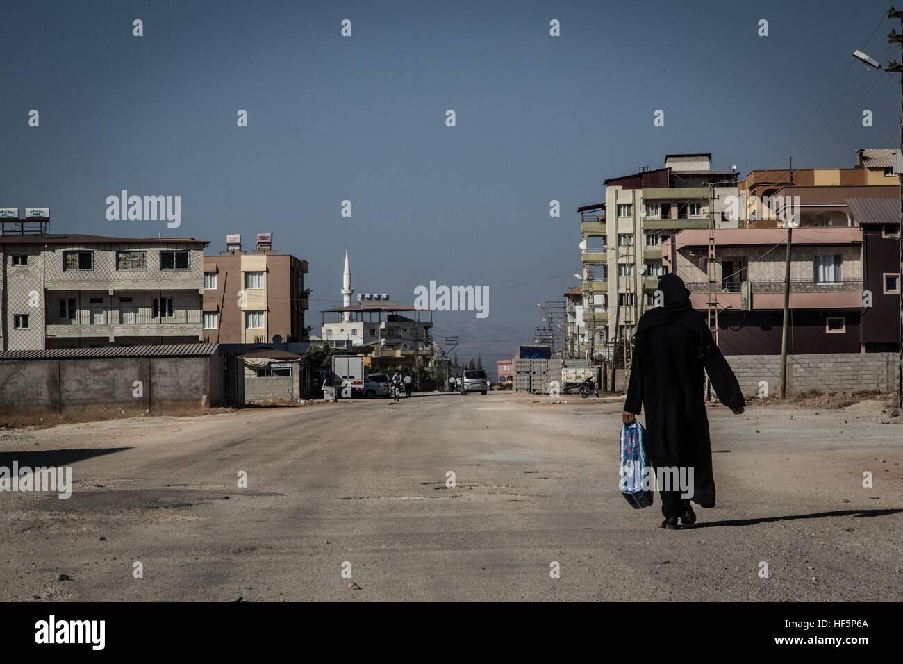 Turkey - Reyhanli - Smugglers' Town -  22/09/2015  -  Turkey / Hatay / Reyhanli  -  A veiled woman walks along main Stock Photo
