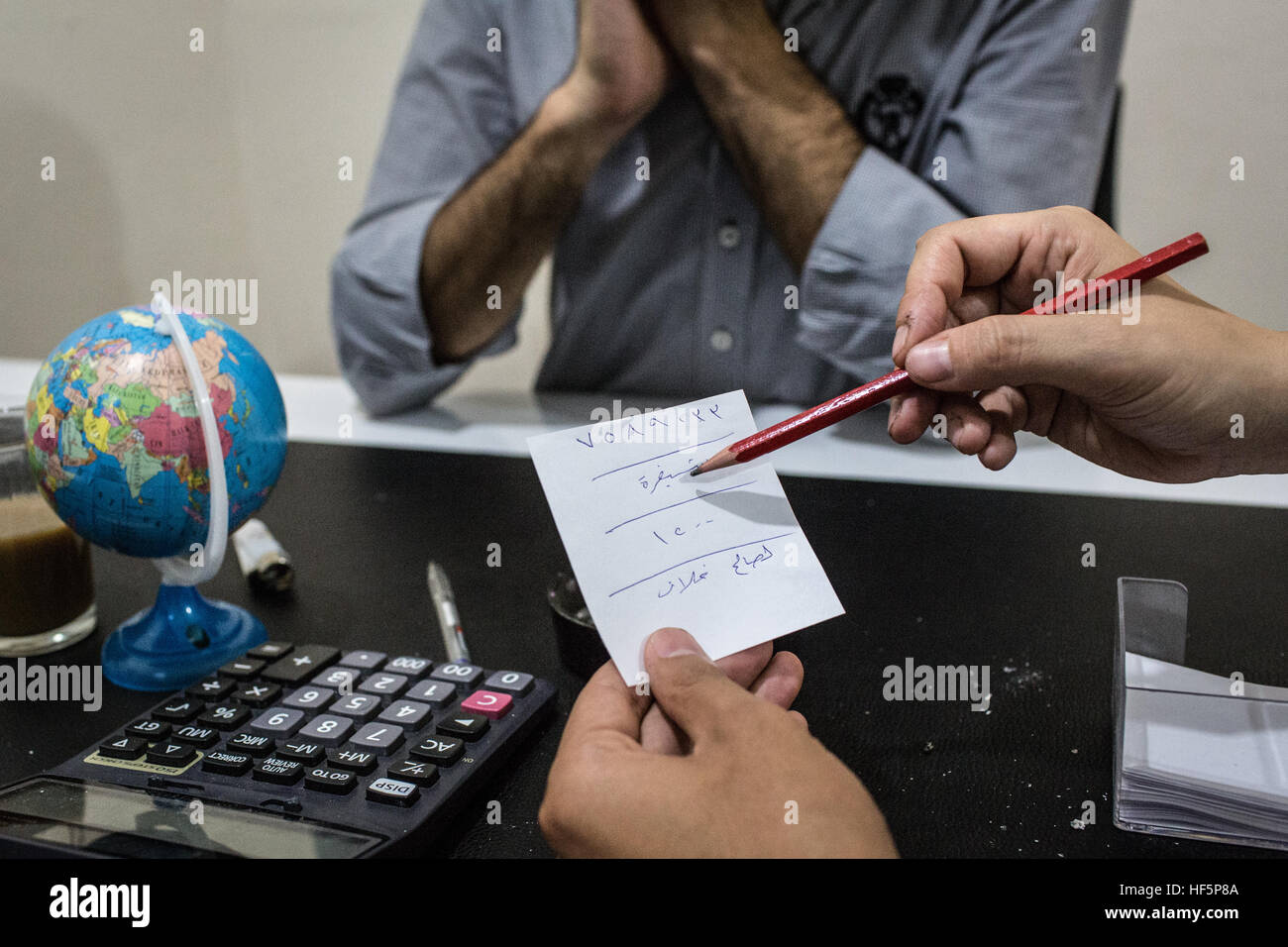 Refugee smugglers -  16/09/2015  -  Turkey / Turkey / Izmir  -  Youssef, the banker. Former refugee who became responsible Stock Photo