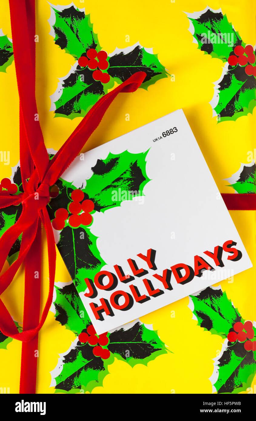 gift wrapped box of Lush Jolly Hollydays fresh handmade cosmetics - Stock Image