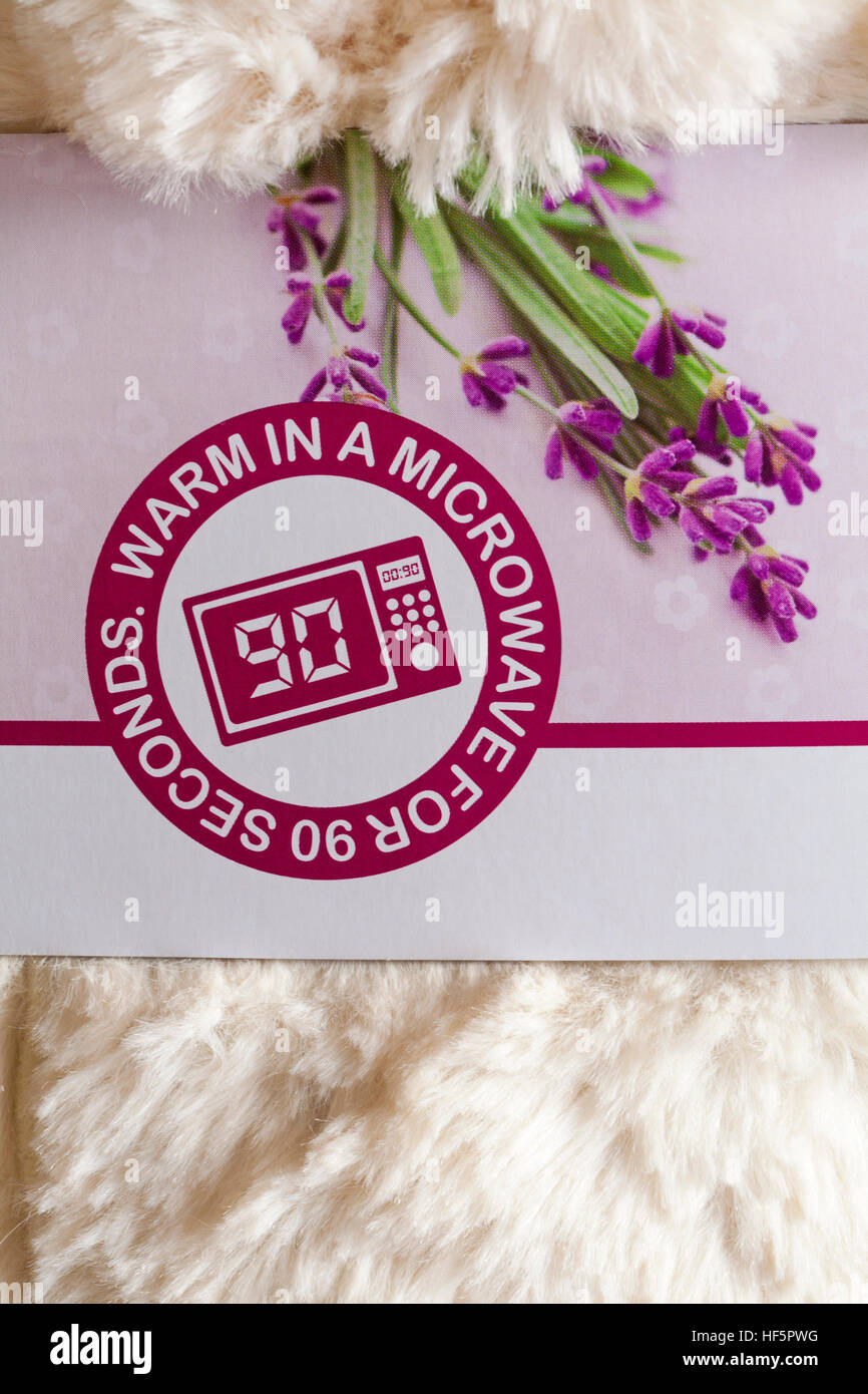 warm in a microwave for 90 seconds - Pair of Warmies Heatable Boots soothing warmth and comfort scented with relaxing - Stock Image