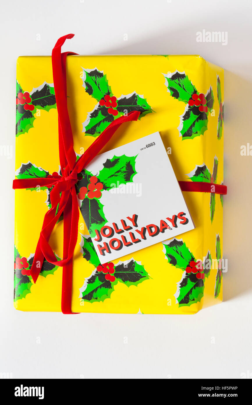gift wrapped box of Lush Jolly Hollydays fresh handmade cosmetics isolated on white background - Stock Image