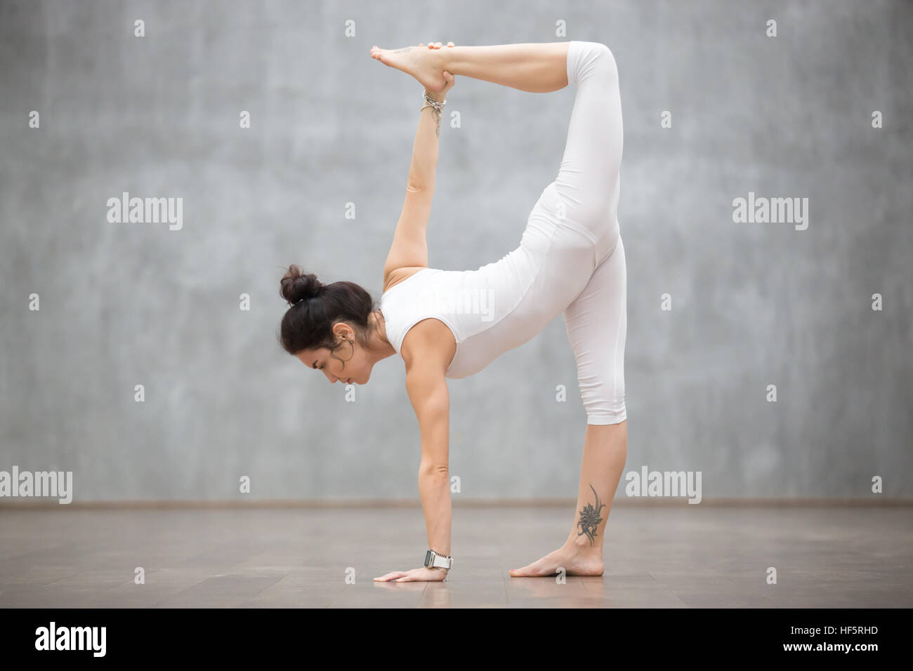 Beautiful Yoga: Half Moon pose - Stock Image