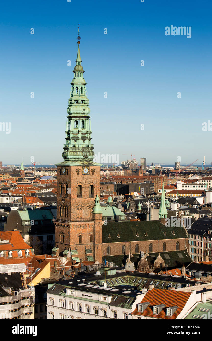 Denmark, Copenhagen, tower and spire of old Saint Nicolas' church, now St Nicolaj Kunsthal Contemporary Art Centre - Stock Image