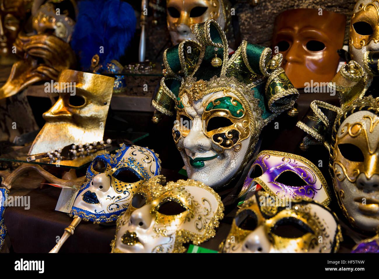 Denmark, Copenhagen, Højbro Plads, Christmas Market, Venitian Carnival masks for sale on Italian produce stall - Stock Image