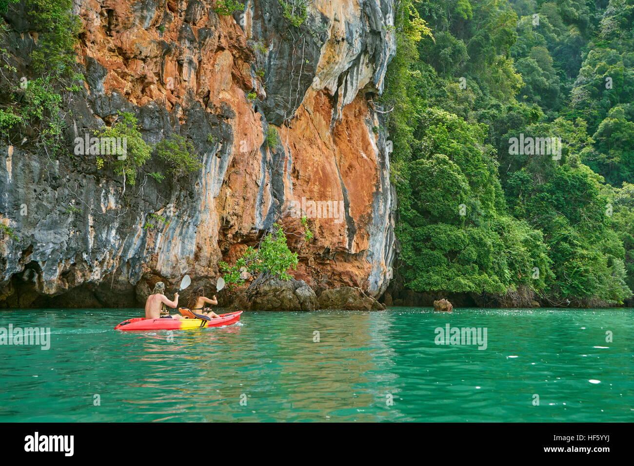 Kyaking at Ko Talabeng Island, Krabi Province, Thailand - Stock Image