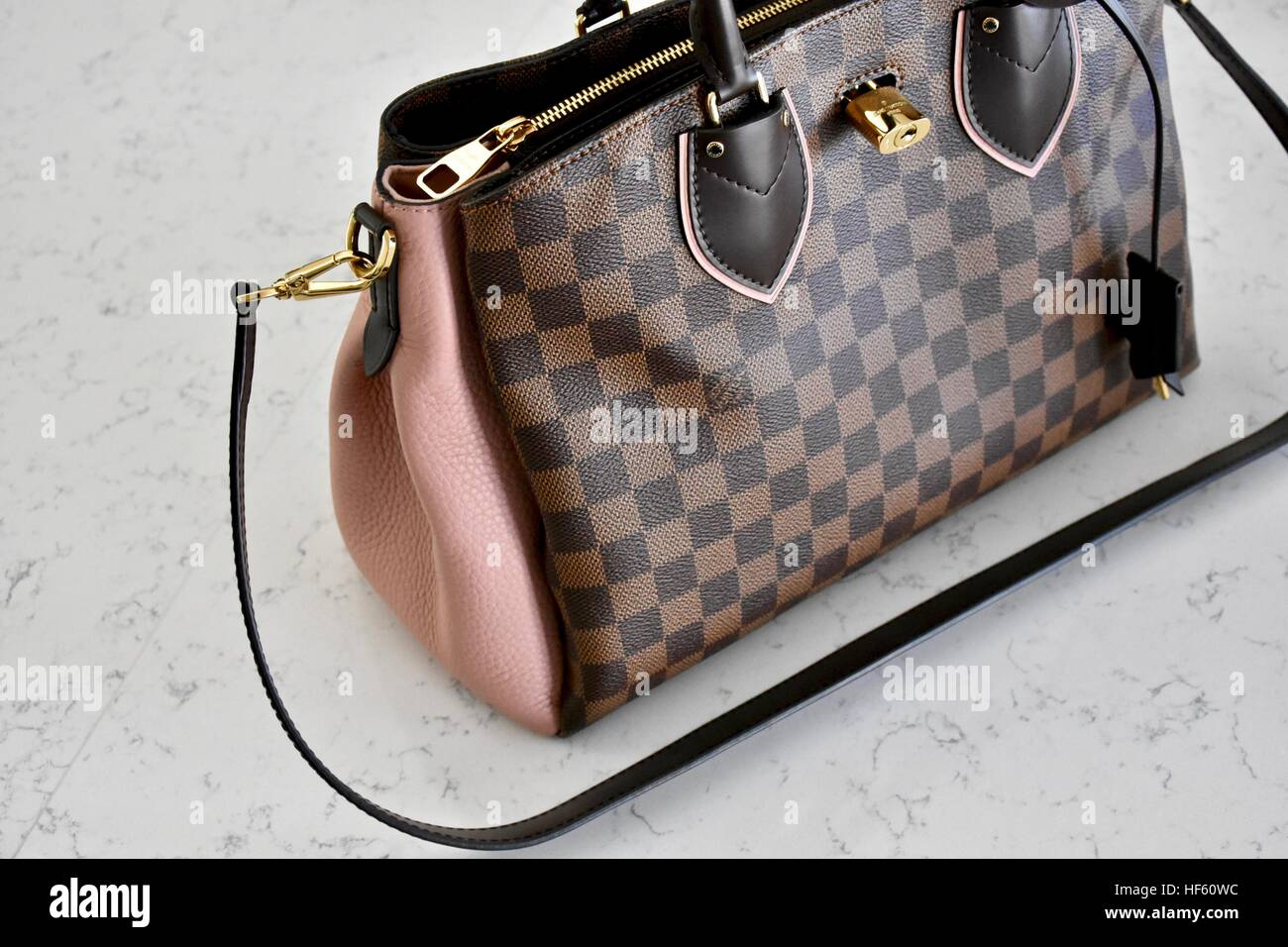 87035a3eae73 A Louis Vuitton handbag displayed on a white carrera marble background -  Stock Image