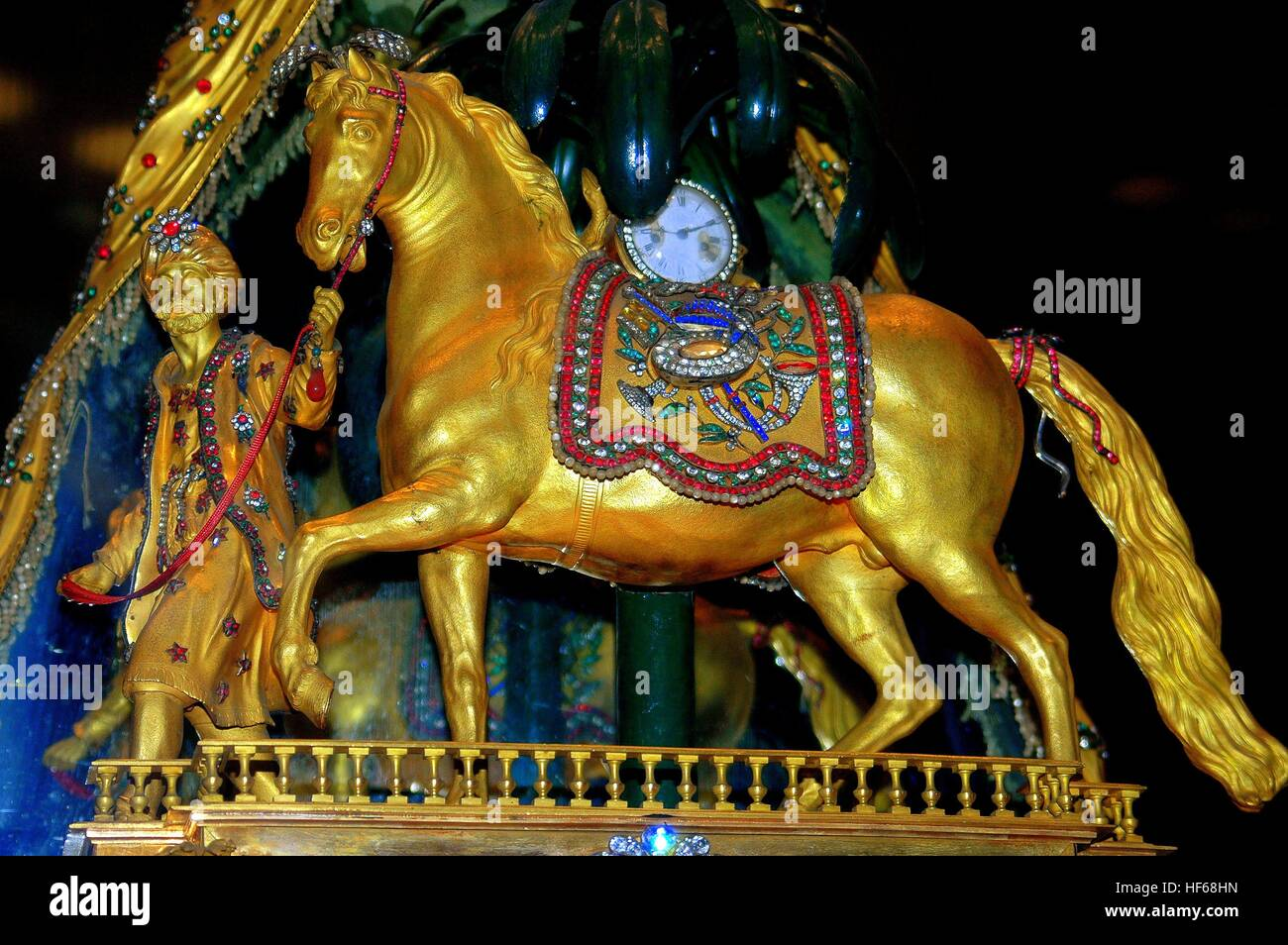 Beijing, China - May 2, 2005:  Gilded horse is one of the treasures on display in the Hall of Clocks Museum of the - Stock Image