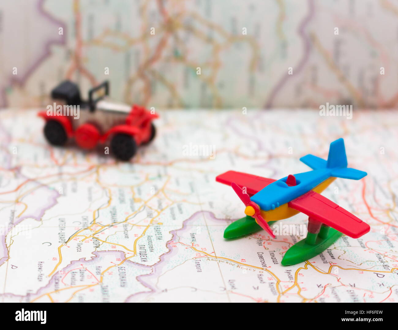 Miniature car and airplane on map travel around the world stock miniature car and airplane on map travel around the world wallpaper gumiabroncs Image collections