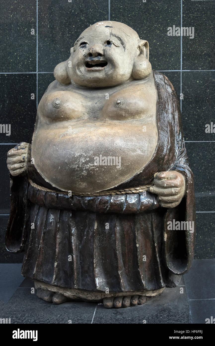 Fat jolly Buddha statue, Matsubara Dori, near Kiyomizu-dera Buddhist  temple, Kyoto, Japan Stock Photo