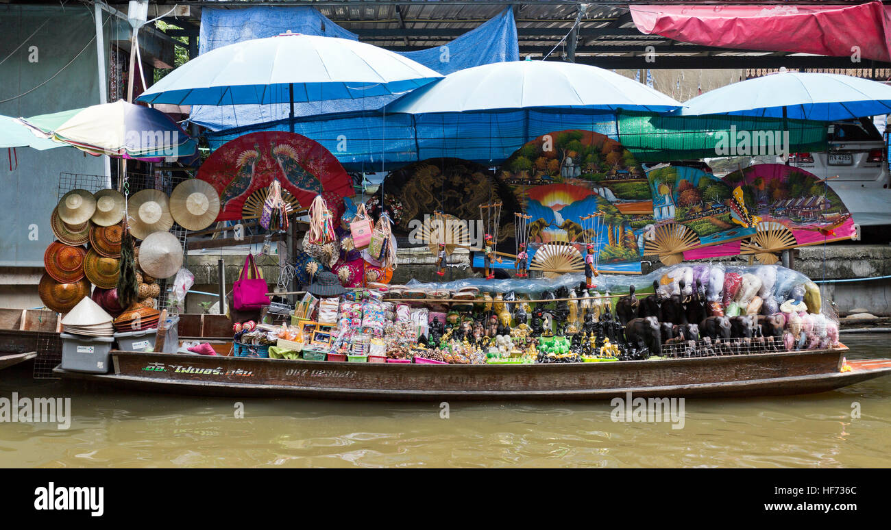 Stall selling local souvenirs along the floating markets of Bangkok, Thailand - Stock Image