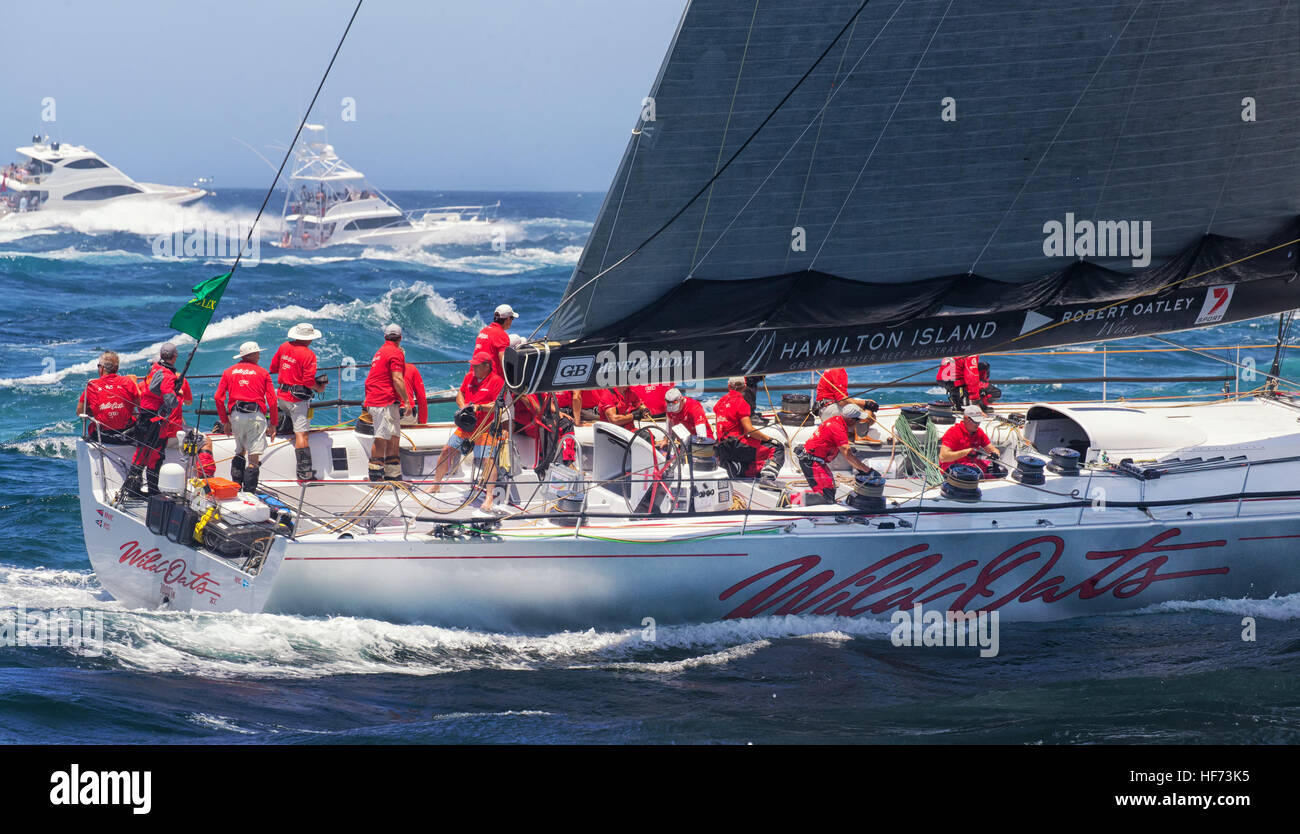 The super-maxi Wild Oats XI heads down the coast in the annual Sydney to Hobart yacht race. - Stock Image