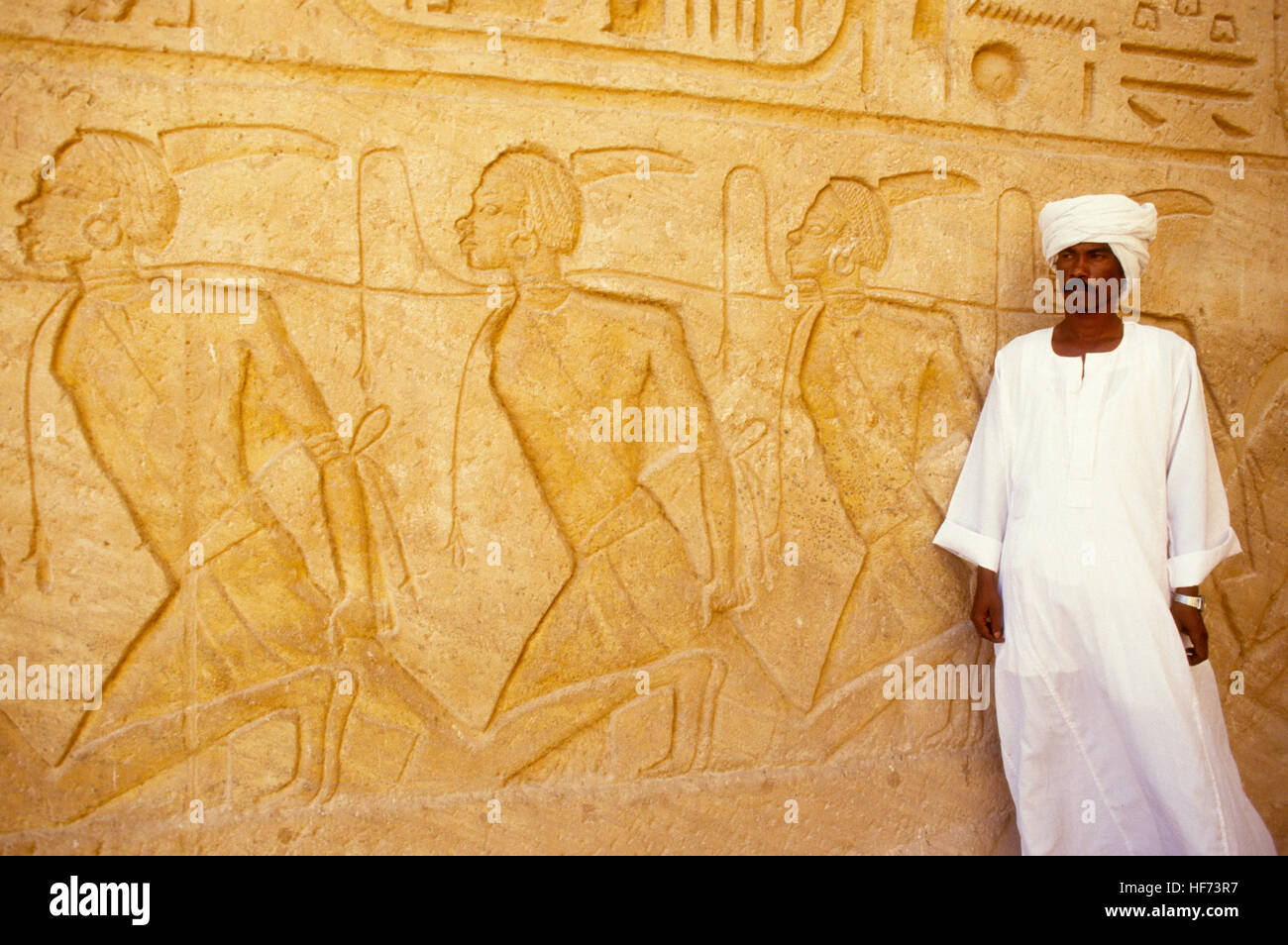 ABU SIMBEL temples Egypt 1999  Official of reliefs where the kings worship the Falcon headed Ra-harakhti - Stock Image