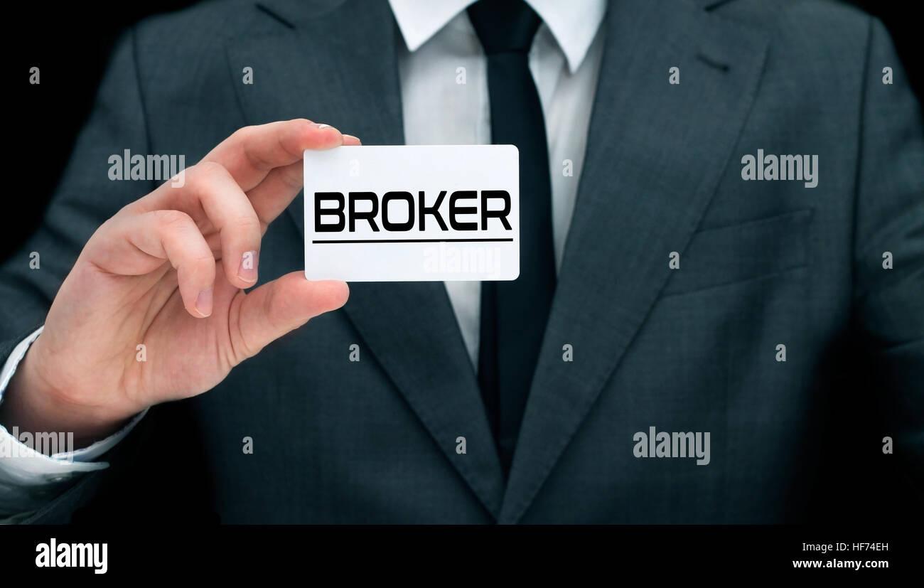 Young broker showing his business card concept of providing advice young broker showing his business card concept of providing advice by financial advisor colourmoves
