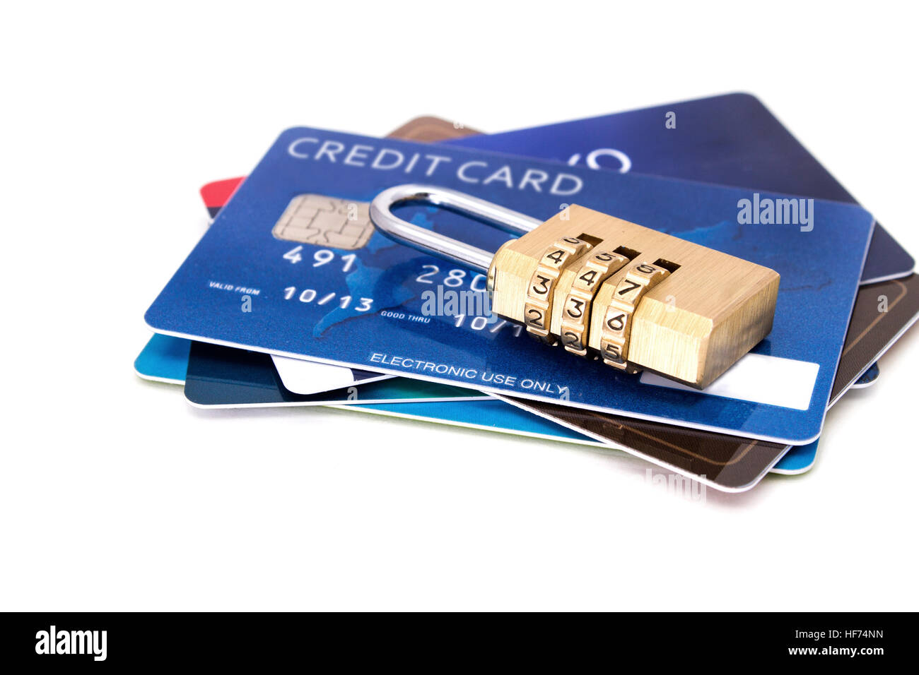 Credit cards and combination lock padlock. Credit card security concept - Stock Image