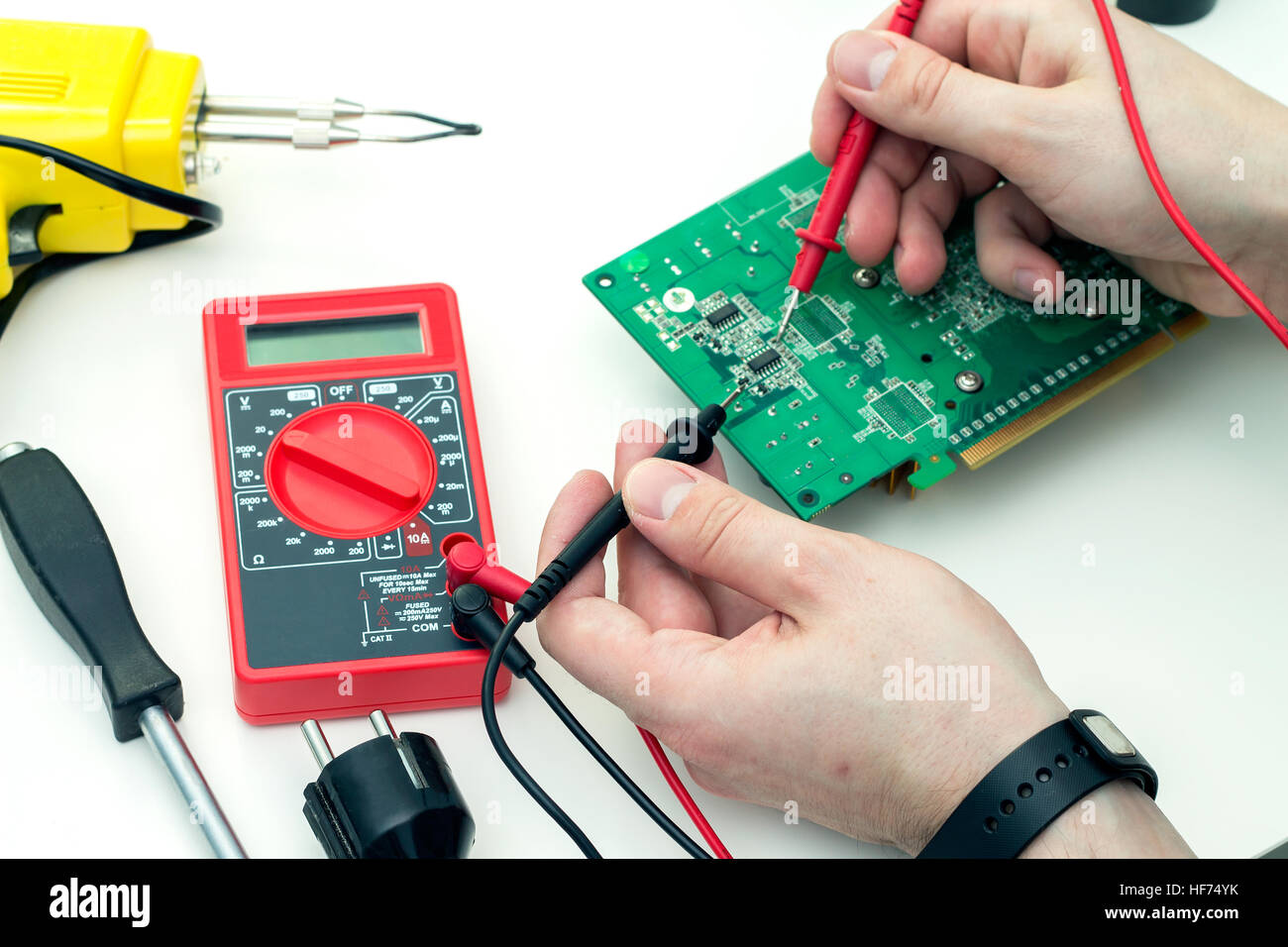 Electrician Part Stock Photos Images Alamy Glass On The Electronic Schematic Diagramideal Technology Background Checks Hardware With A Multimeter In Workshop Image