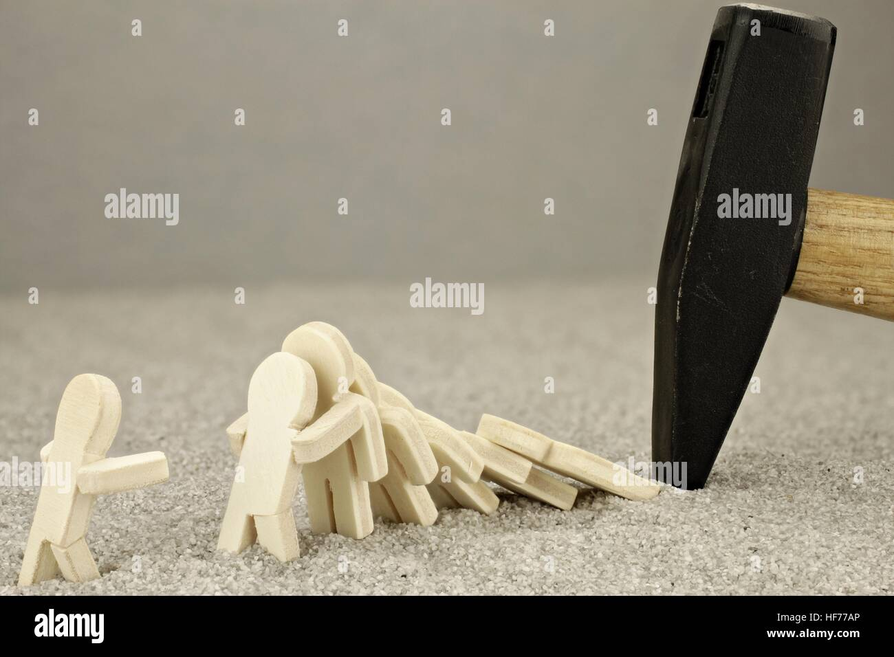 Terror scene with wooden men and hammer Stock Photo