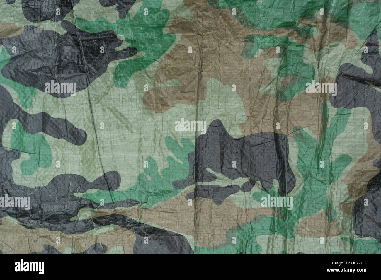 Section of camouflage ground sheet material. - Stock Image