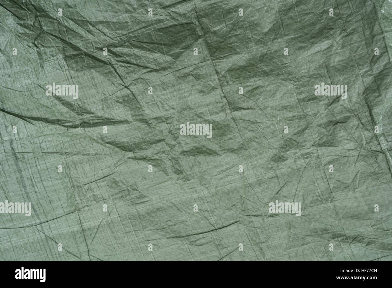 Section of green camouflage ground sheet material. - Stock Image