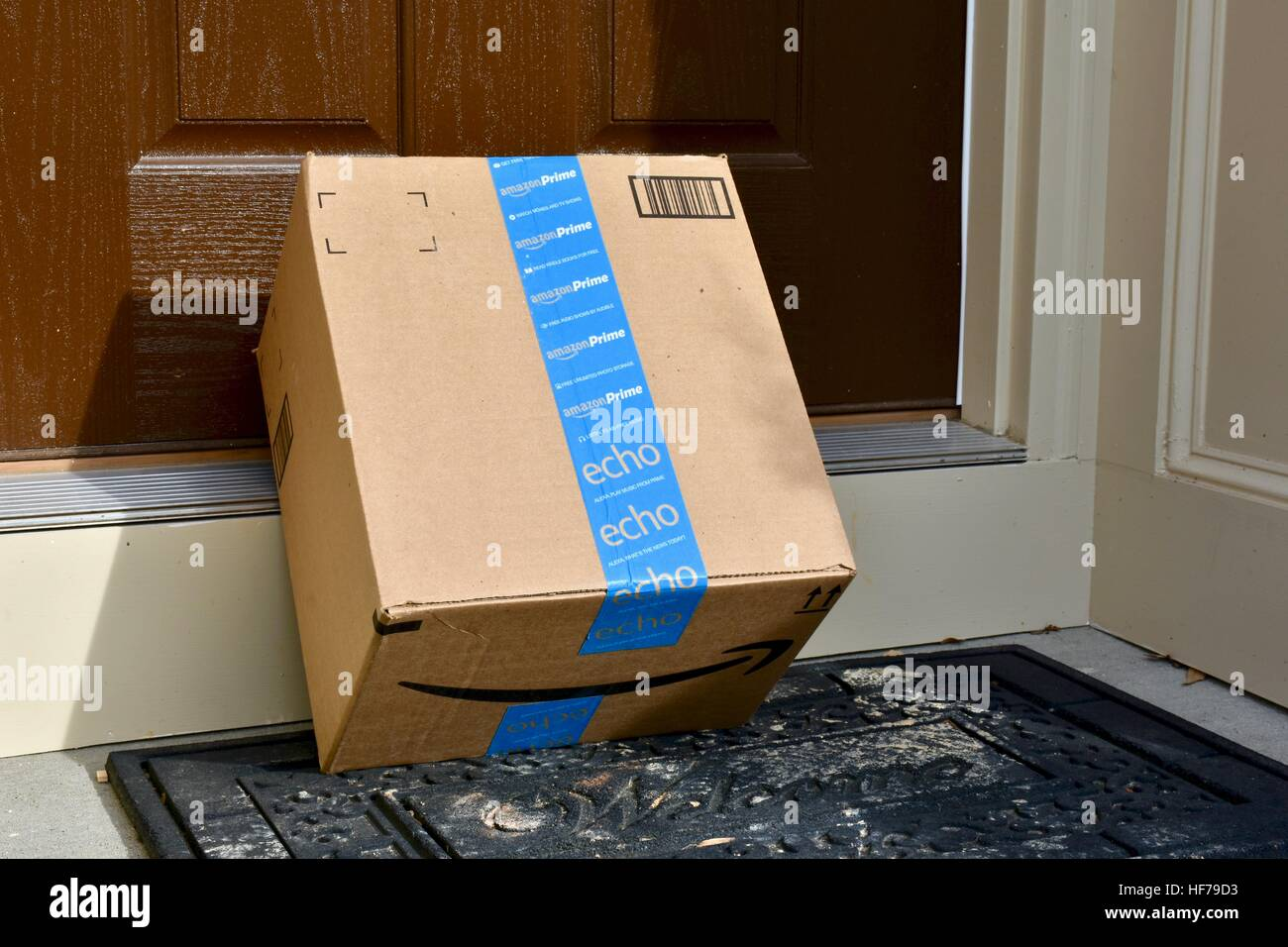 An Amazon Prime package delivered to the front door of a home & An Amazon Prime package delivered to the front door of a home Stock ...