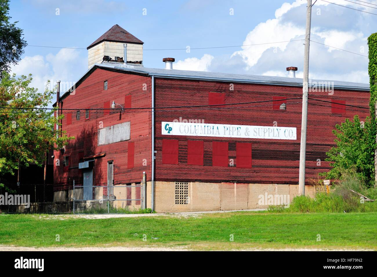 A venerable manufacturing company in the old river town of Elgin, Illinois, USA. - Stock Image