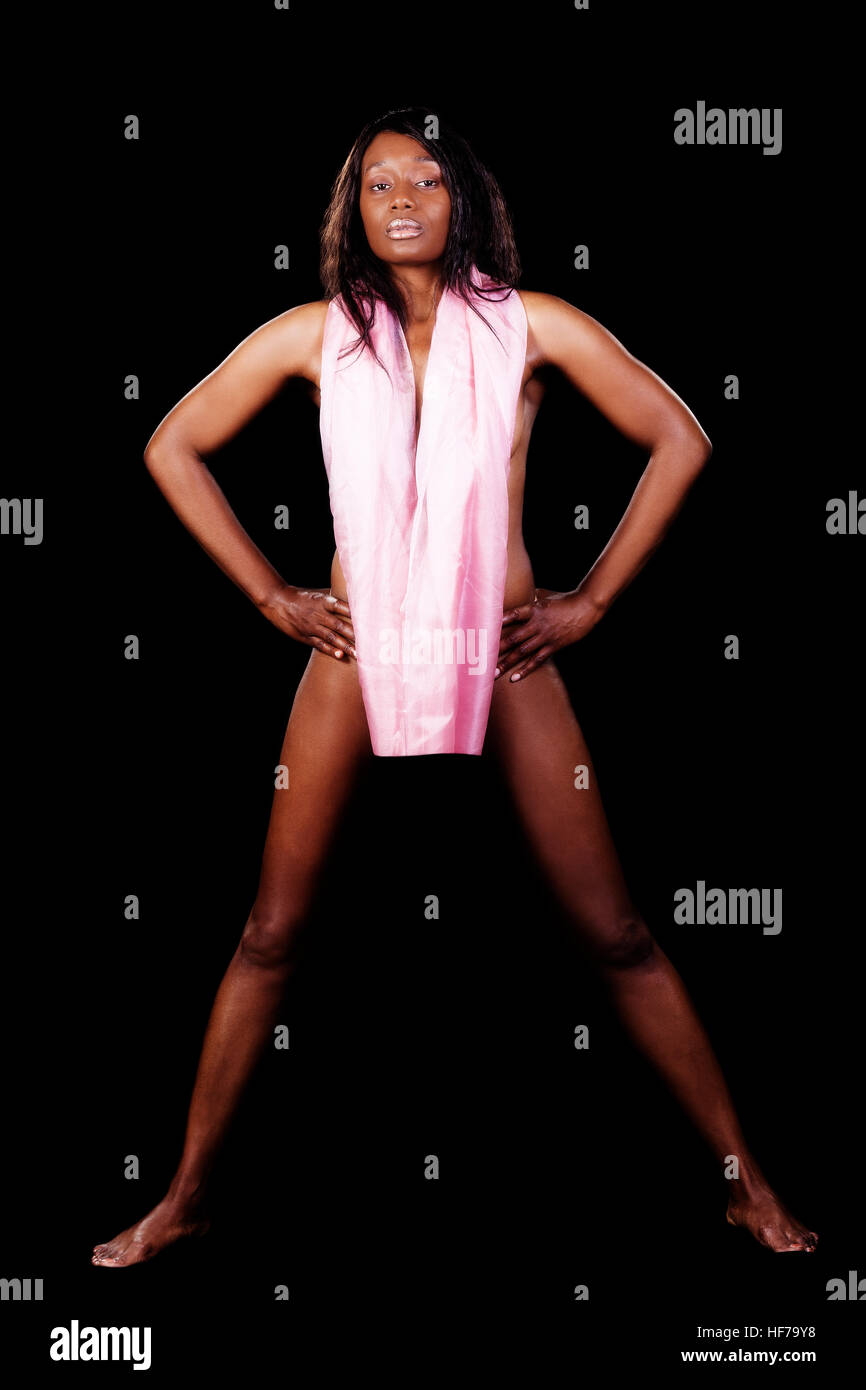Attractive African American Woman Standing Implied Nude With Pink Cloth Arms Akimbo Stock Photo