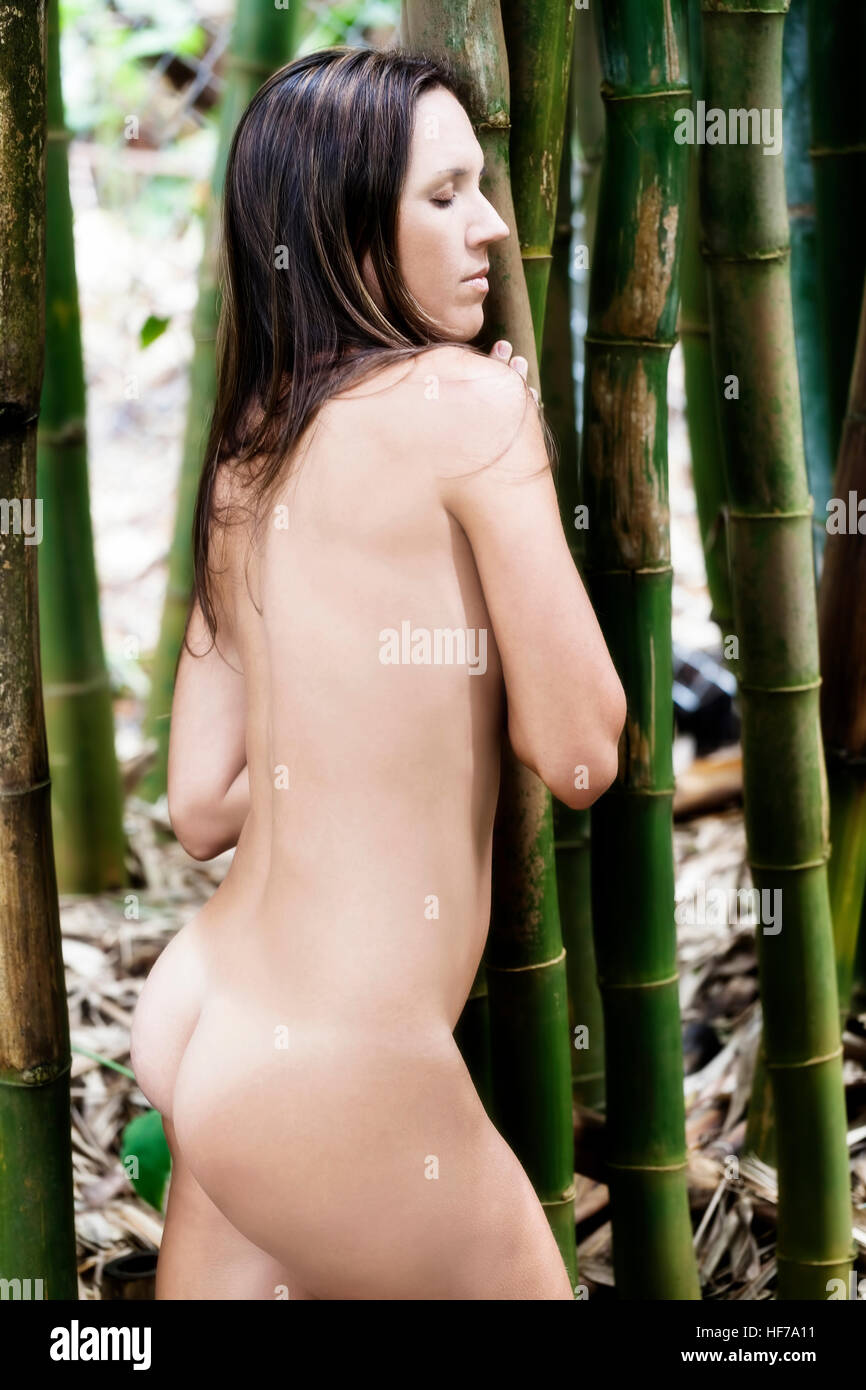 Caucasian Woman Back Eyes Closed Leaning On Bamboo Plants Bare Stock Photo