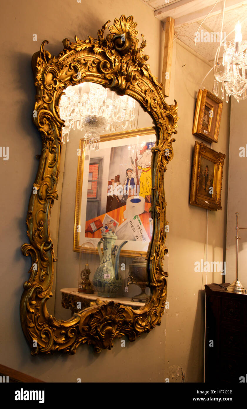 Baroque gilt mirror and Robert Ballagh painting in a Matthews Stock ...