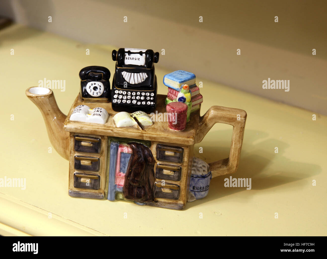 novelty teapot as writer's desk - Stock Image
