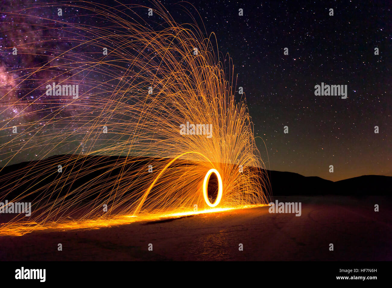 Glowing Sparks and the Milky Way Stock Photo