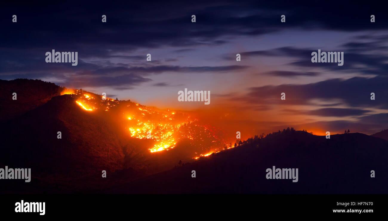Burning Wildfire at Sunset - Stock Image